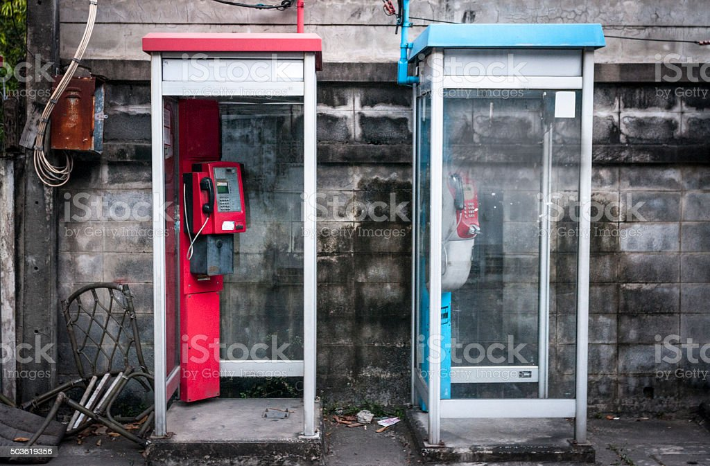 Two Rundown Phone Booths In Bangkok, Thailand stock photo