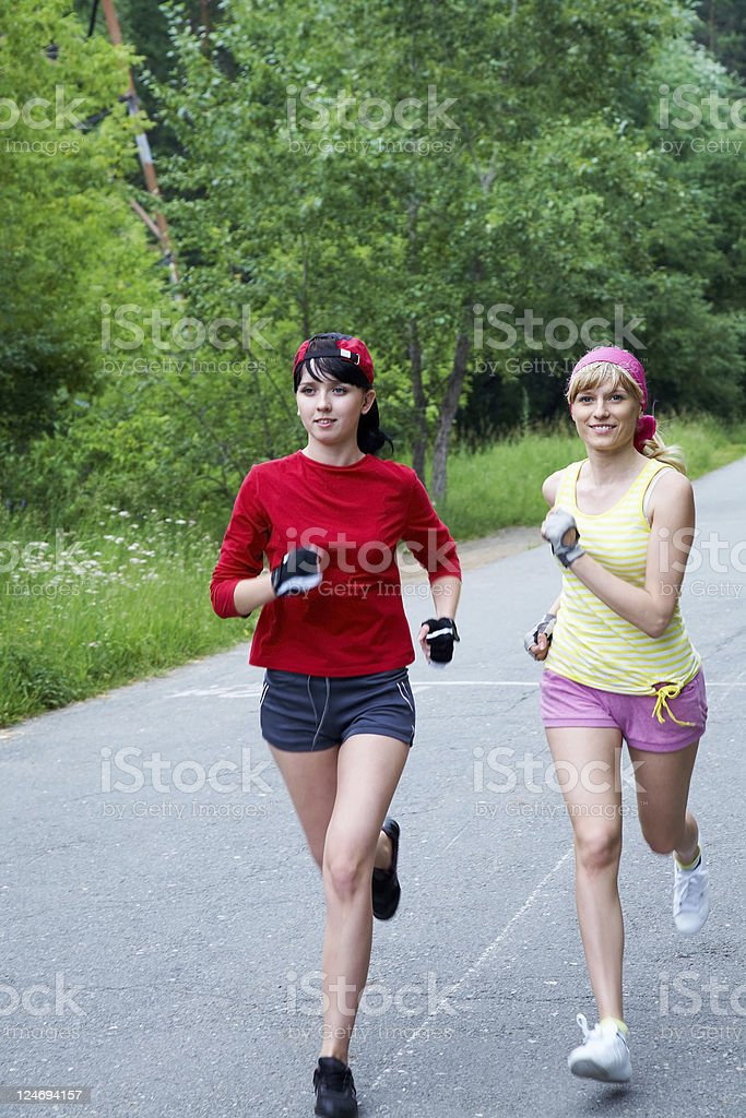 Two running woman stock photo