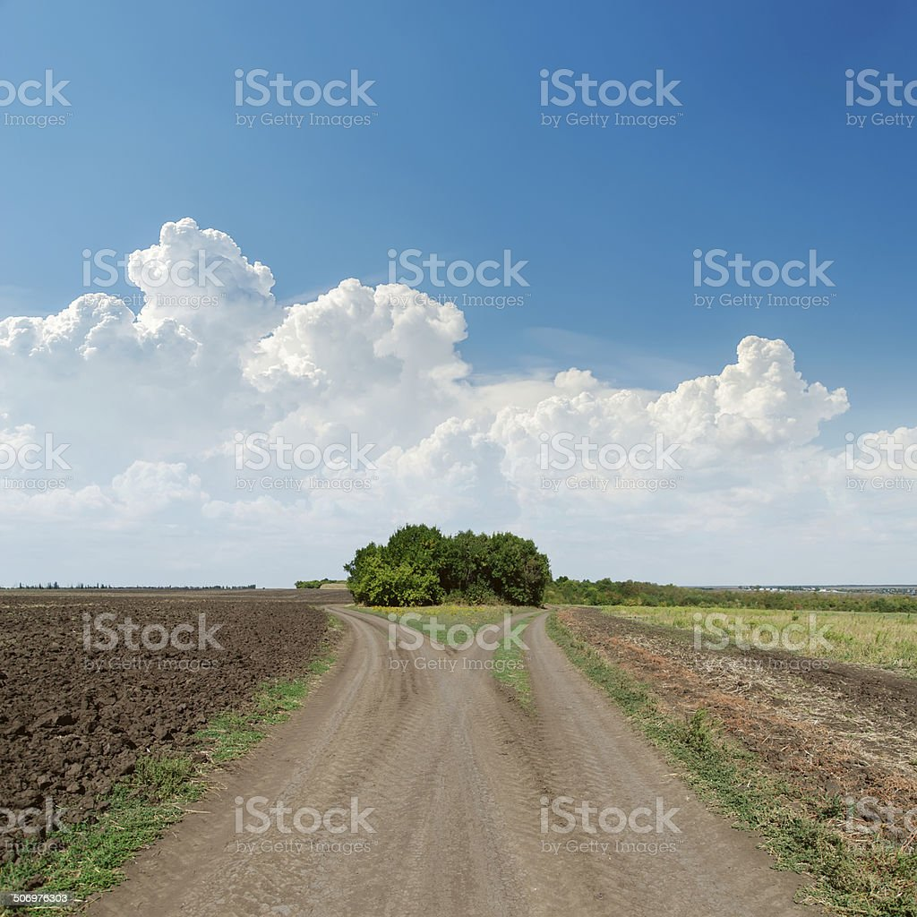 two rural roads and clouds in blue sky stock photo