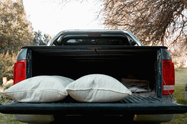 Two sacks of fertilizer in a pick-up truck on a farm stock photo