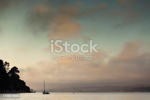 2 sailboats docked in Bay at Sunset.