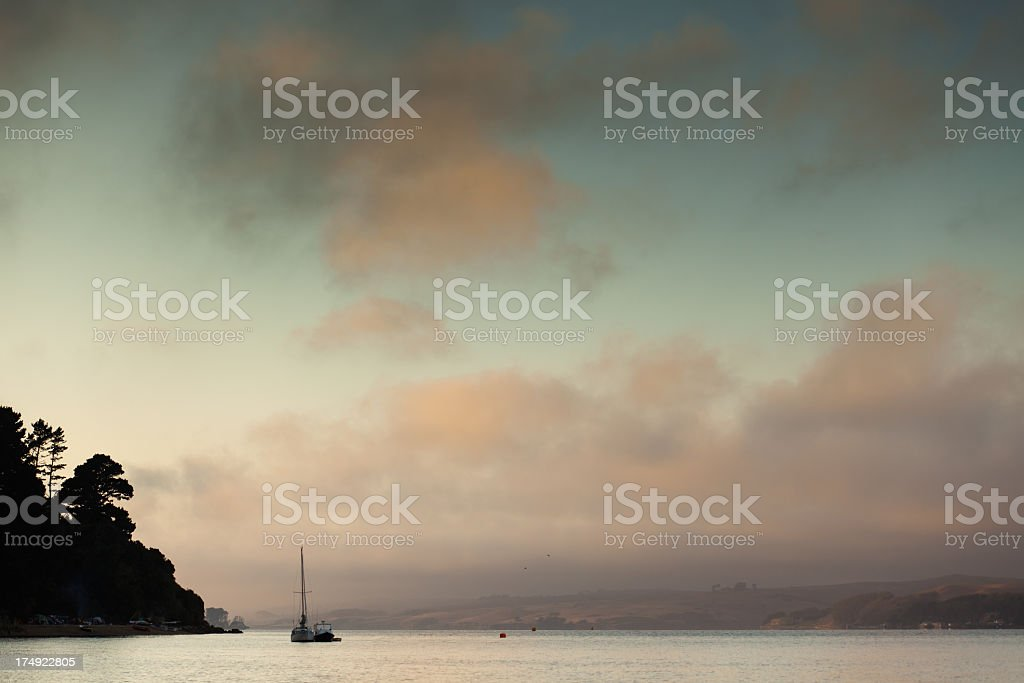 Two Sailboats Docked at Sunset stock photo