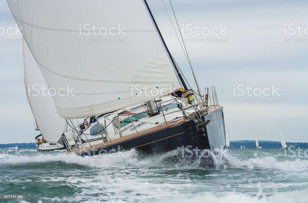 Two sailing boats, sail boats or yachts racing at sea stock photo