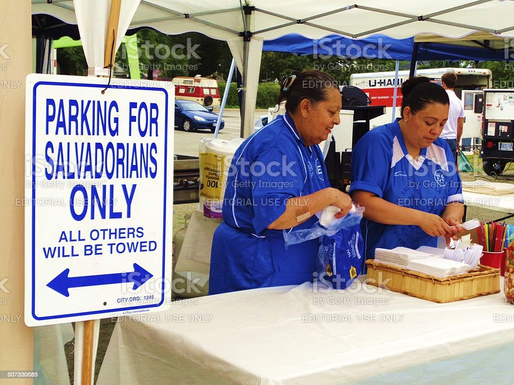 Two Salvadorian Women and parking sign stock photo