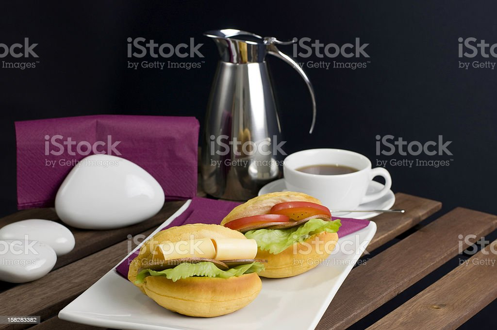 Two sandwich, white china plate, cup of tea and thermos royalty-free stock photo