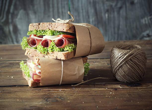 zwei sandwichs mit schinken - käse wurst salat stock-fotos und bilder