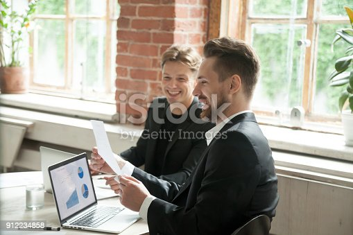 istock Two satisfied executives discussing successful project growth statistics in office 912234858
