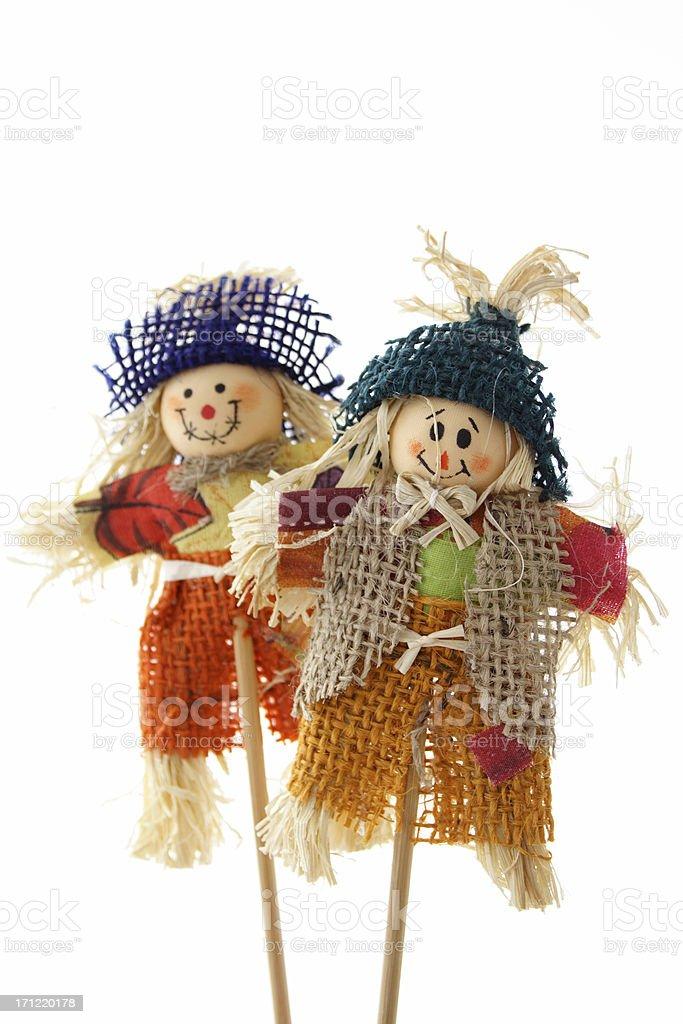 Two scarecrows on stick royalty-free stock photo