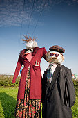 two scarecrows in the field