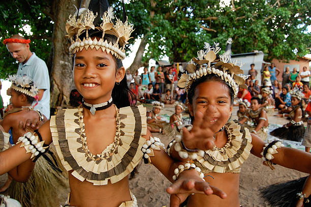two school children performing traditional dance - fiji stock photos and pictures