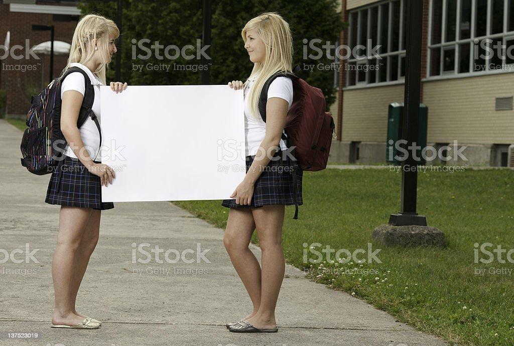 Two Schoolgirl School Yard Poster stock photo