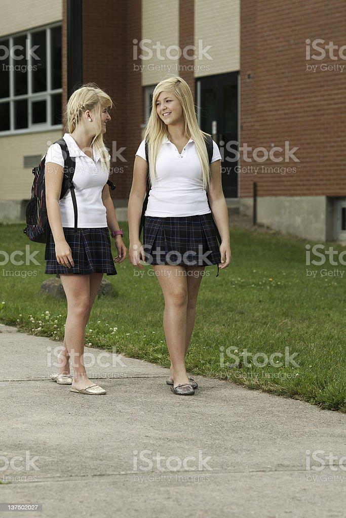 Two Schoolgirl Smile School Yard stock photo