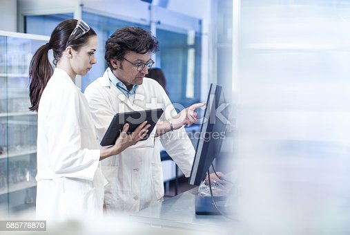istock Two Scientist Looking at the Computer Monitor 585776870
