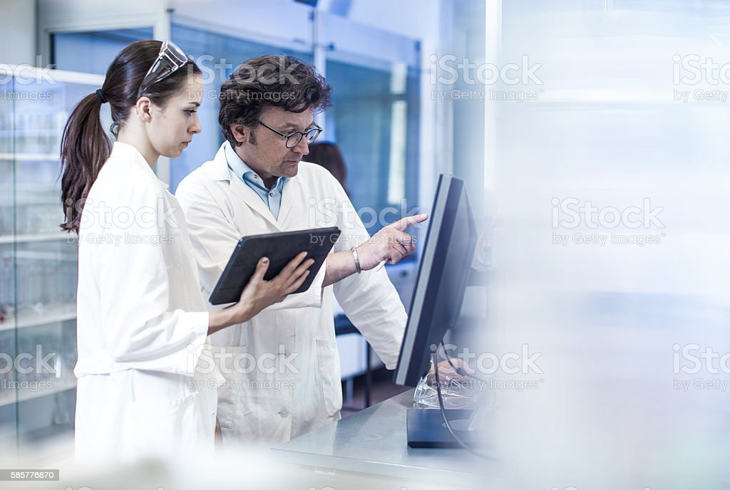 Two Scientist Looking at the Computer Monitor stock photo