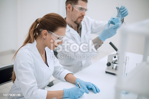 661098200istockphoto two scientists work in the laboratory 1027906136