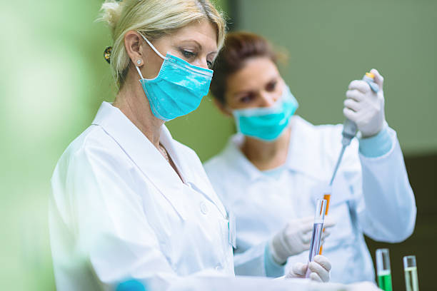 Two scientists working in laboratory stock photo