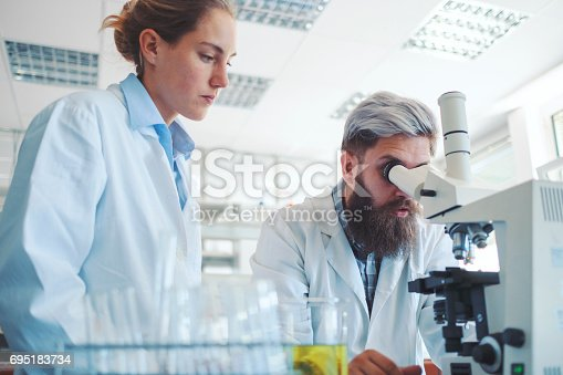 istock Two scientists working in laboratory 695183734