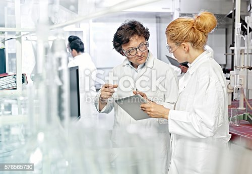istock Two Scientists working on computer in a lab 576565730