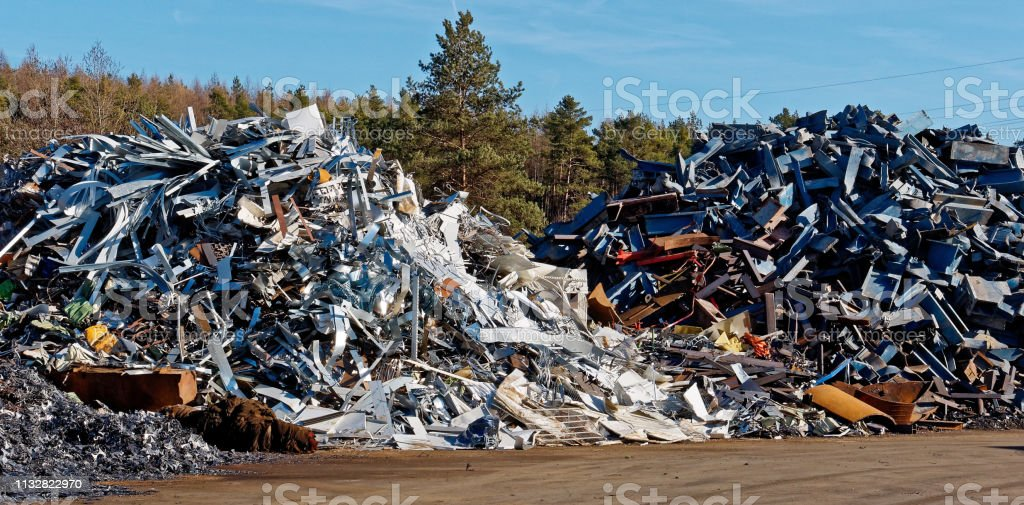 two scrap metal heaps stock photo