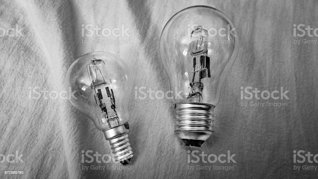 Two screw-fit ligh-bulbs, one big and one small stock photo