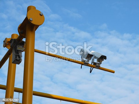 istock two security cameras on yellow pole with blue sky background 503764292