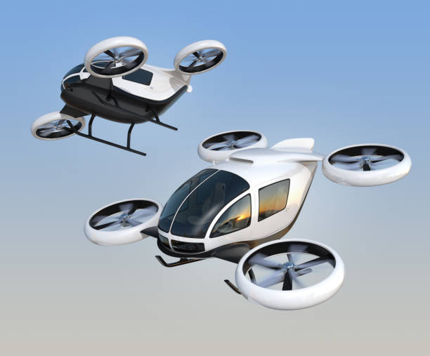 two self-driving passenger drones flying in the sky - veicolo terrestre foto e immagini stock