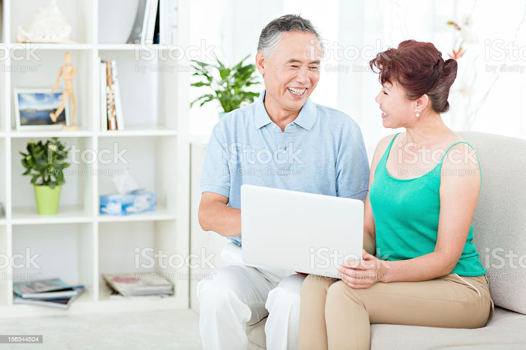 Two senior asian people using computer royalty-free stock photo