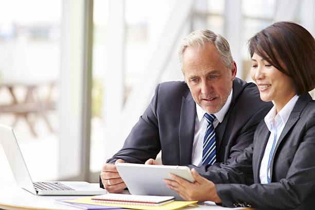 two senior business colleagues at meeting, close-up - professional sport stock photos and pictures