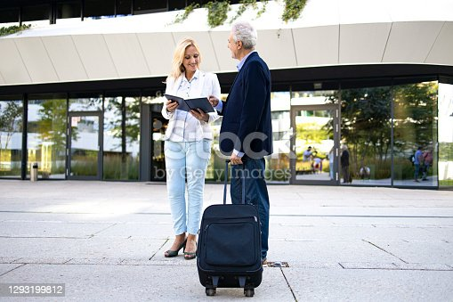 color photography,50-59 years,40-49 years,suit,green color,Serbia,coffee-drink,suitcase,sun,sunny,fashion,senior adult