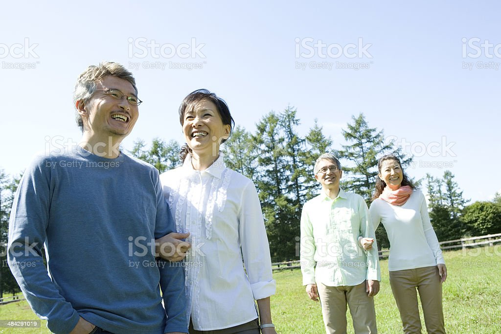 Two senior couples holding their arms stock photo