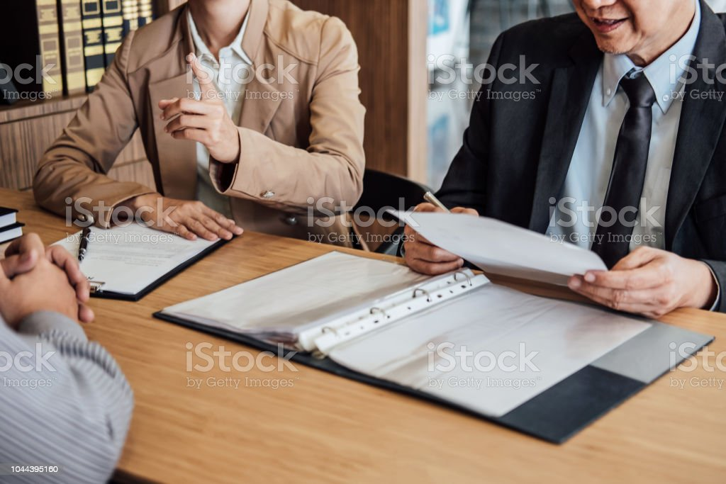 Two Senior Manager Reading A Resume During Job Interview