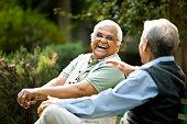 istock Two senior men discussing on park bench 1289142883