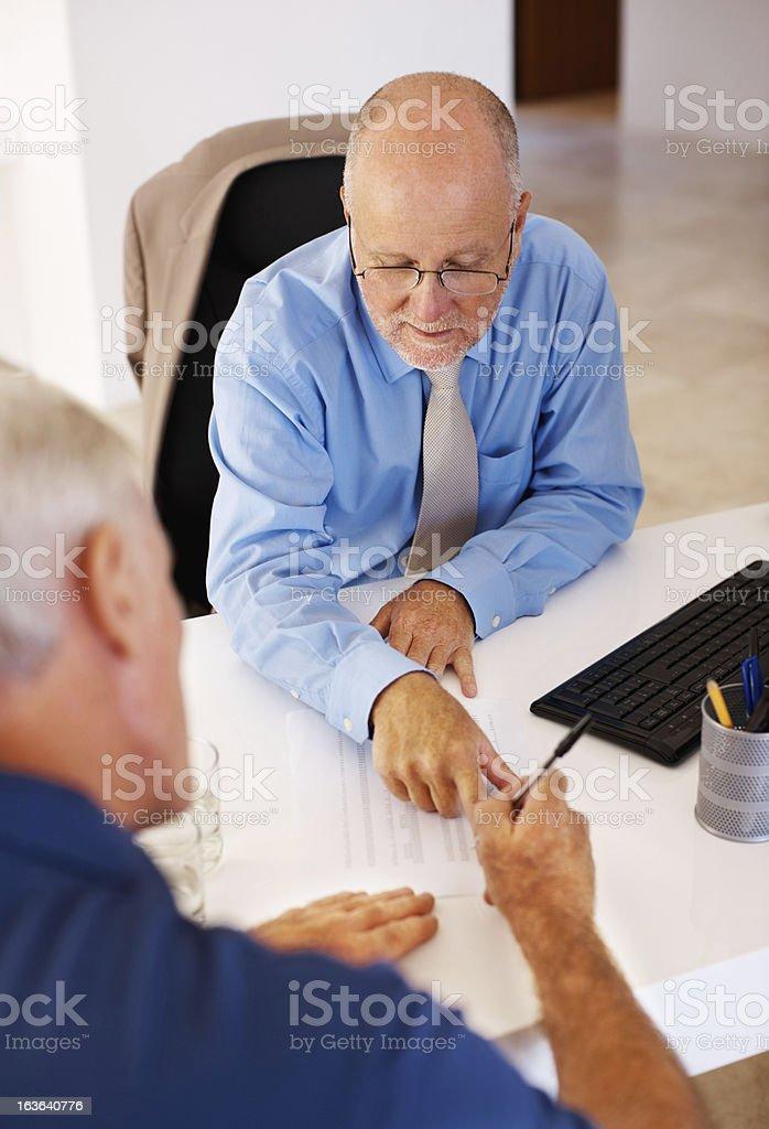 Two senior men filling forms royalty-free stock photo