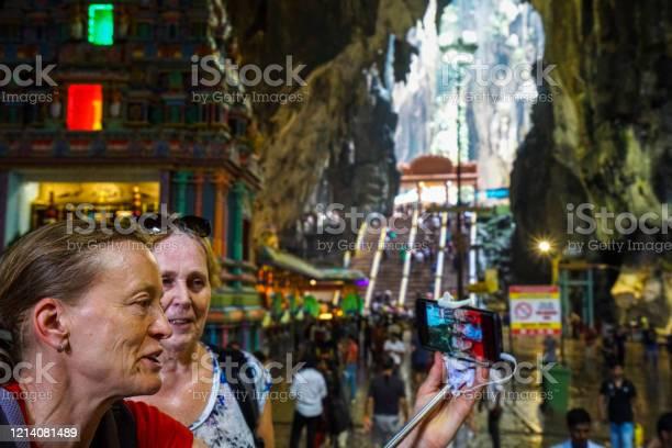 Two Senior Woman Enjoying Batu Caves In Kuala Lumpur Malaysia Stock Photo - Download Image Now