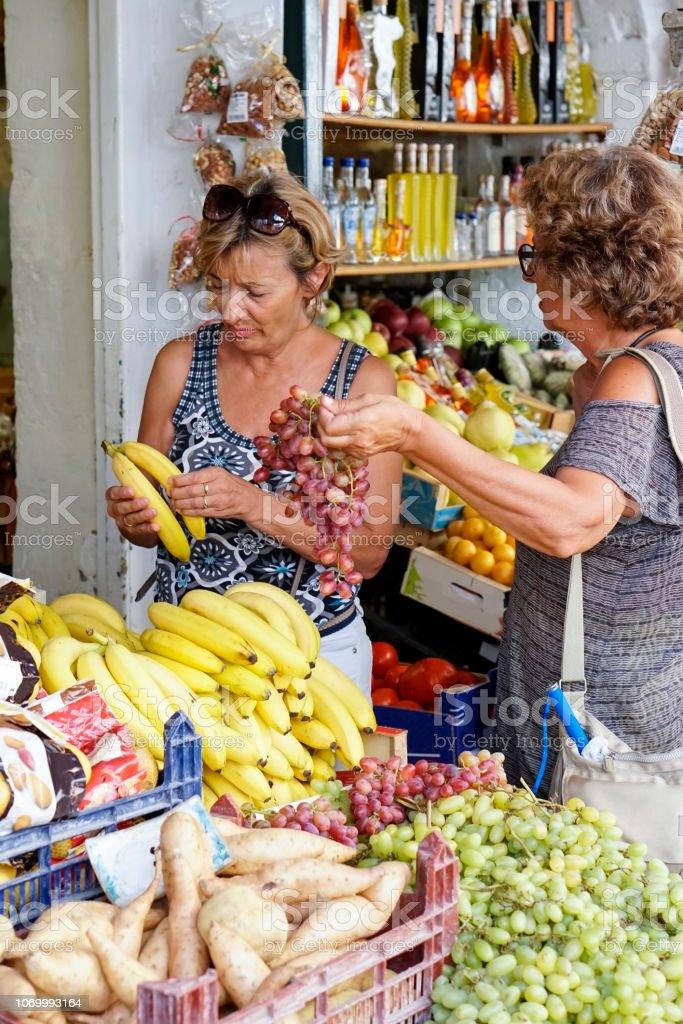 Two Senior women exploring the Corfu town stock photo