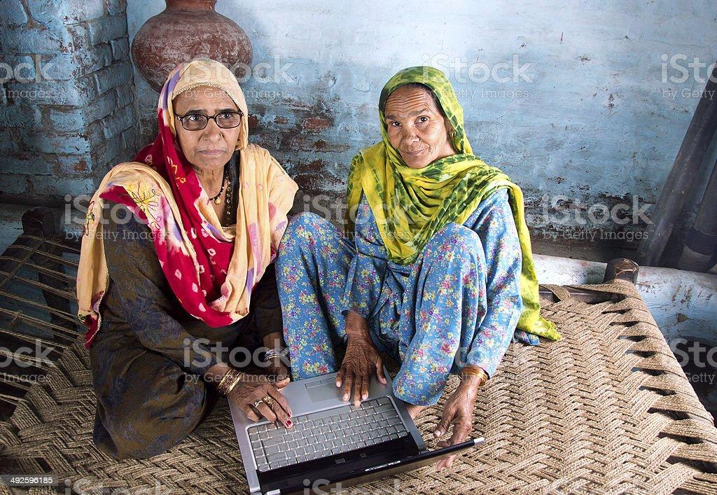 Two Senior Women Using Laptop royalty-free stock photo
