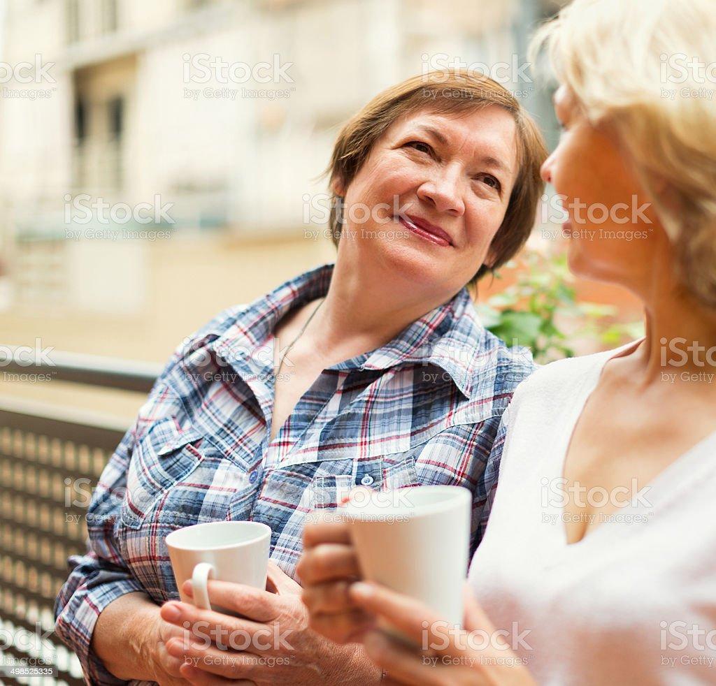 Two seniore women drinking coffee stock photo