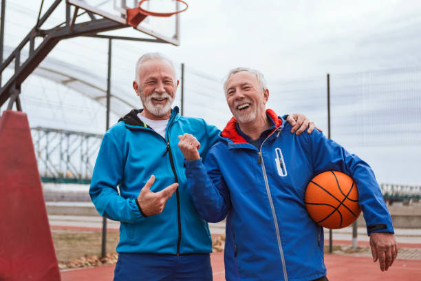 two seniors getting ready to play basketball - older brother imagens e fotografias de stock