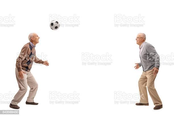 Two seniors passing a football picture id543569430?b=1&k=6&m=543569430&s=612x612&h=8tmvt5ft 3myx u3ckm27ygiqpyojrsqwmcngq56oso=