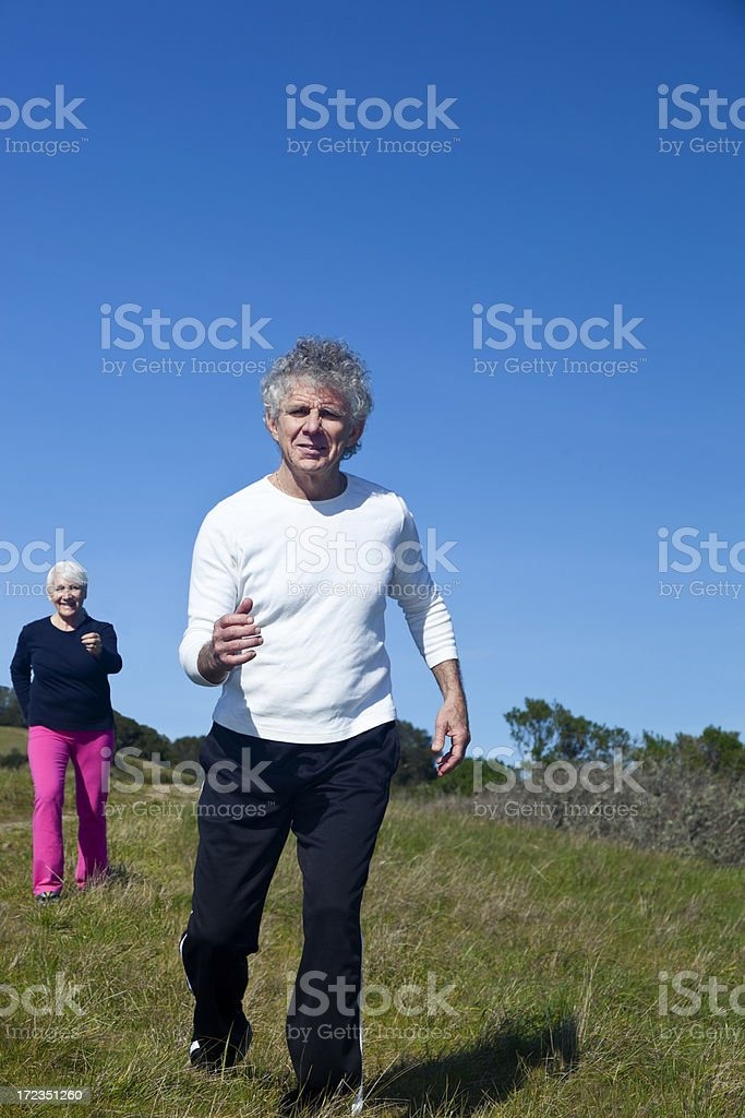 two seniors running royalty-free stock photo