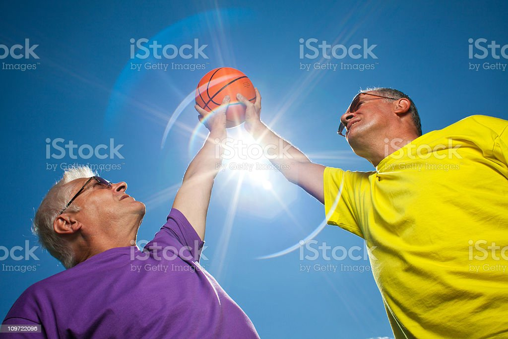 Two seniors with basketball royalty-free stock photo