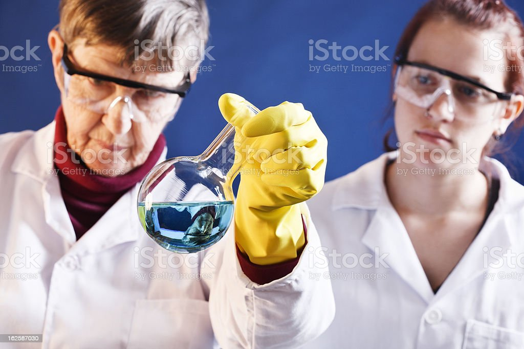 Two serious female scientists working in laboratory stock photo