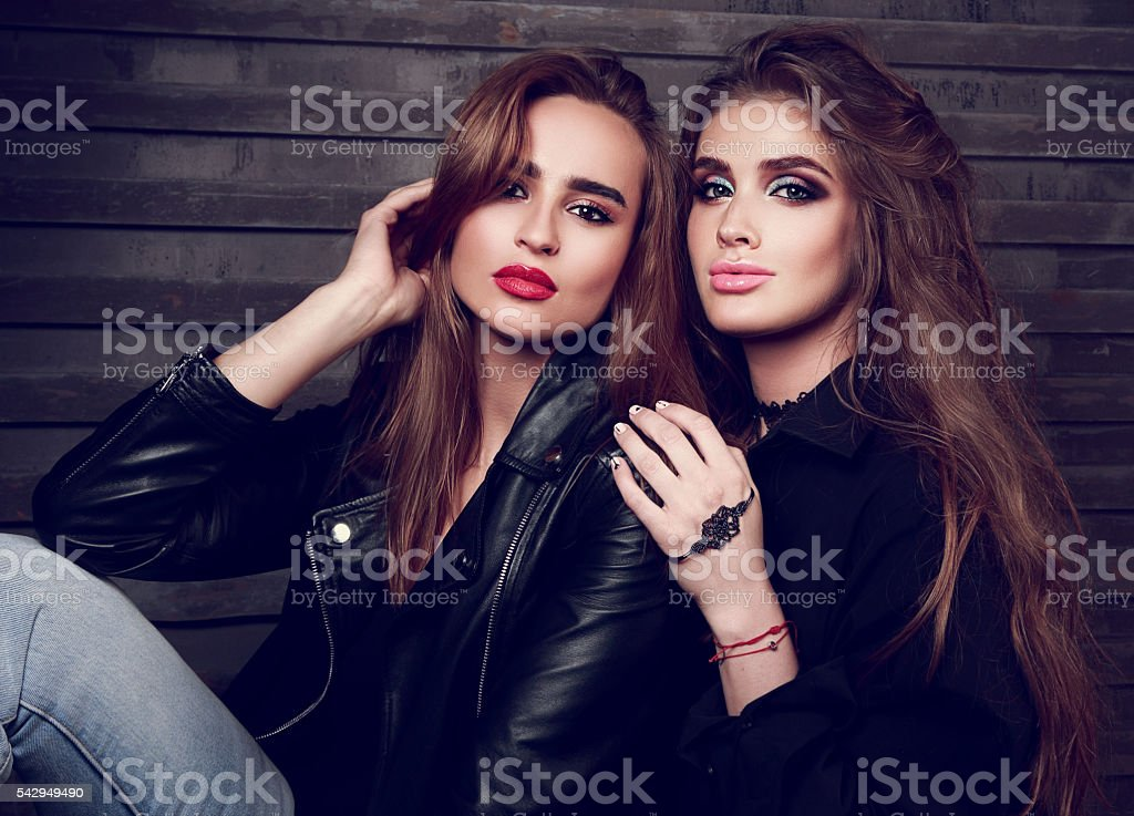Two sexy beautiful woman with bright makeup, long hairstyle stock photo