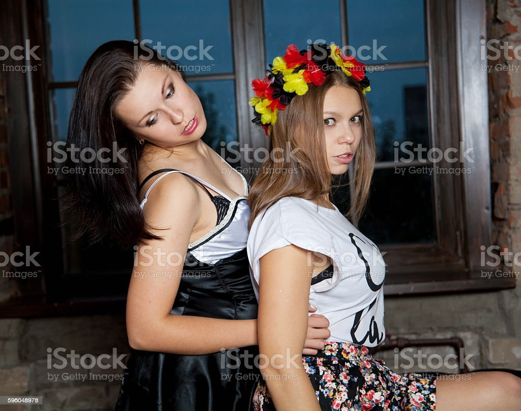 two sexy women hugging on the sofa royalty-free stock photo