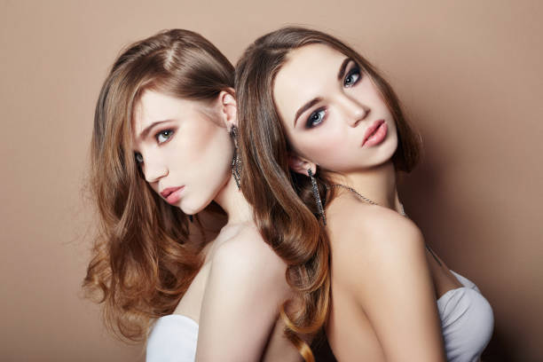 two sexy young blonde hair girls hugging, earrings in ears jewelry on neck and, beautiful eyes. summer skin care eye shadow, fashion natural skin care, face skin art, body beauty nature, spring makeup - spring fashion stock pictures, royalty-free photos & images