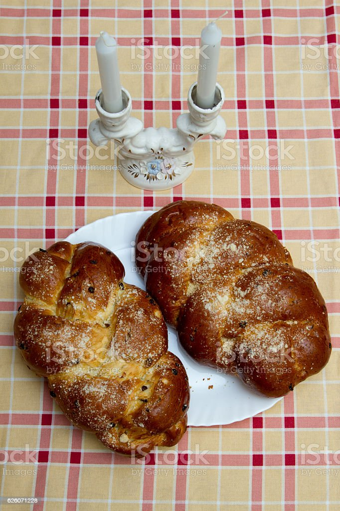 Two Shabbat challah and candlestick stock photo