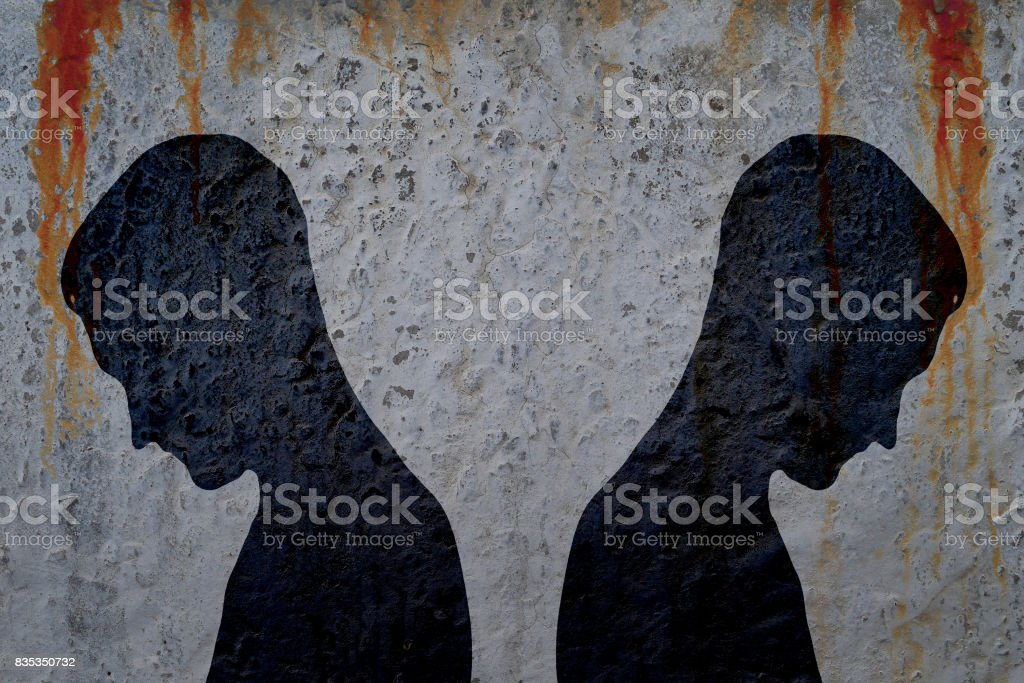 Two shadows of man's body on bloody wall stock photo