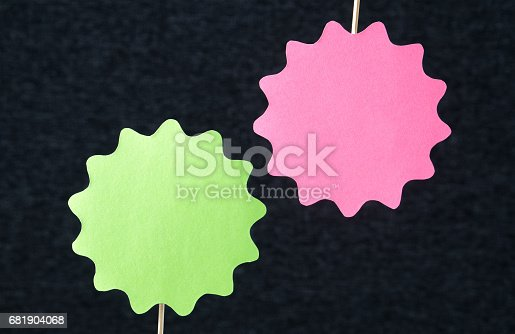 istock Two shaped circles cut from cardboard on a wooden stick. Price, promotion or special offer signs. Template for round paper badge, label, plague or design elements on dark background and copy space. 681904068
