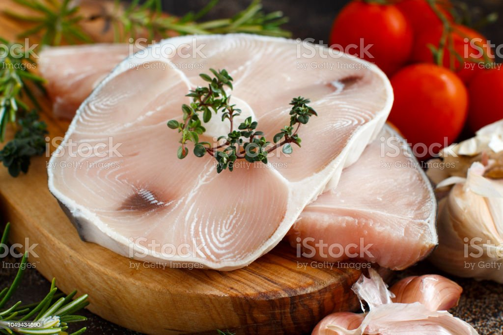 Two shark steak with vegetables and herbs stock photo
