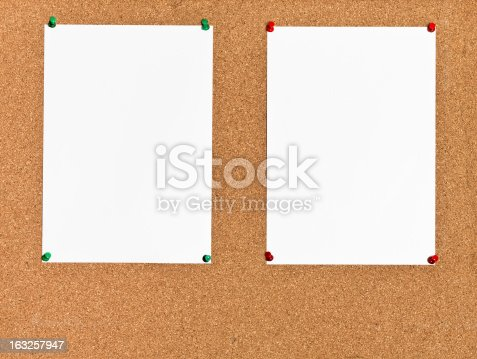 istock two sheets of paper on cork board 163257947